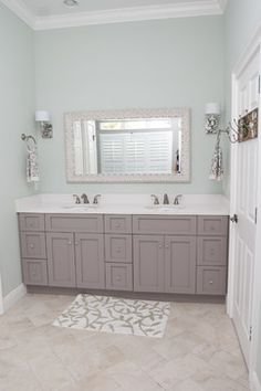 Grey cabinets in bathroom. I really like the wall color