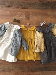 modern vintage baby and toddler dresses | white dress with gray knit cardigan, mustard yellow dress, gray knit dress with yellow cardigan for baby girls