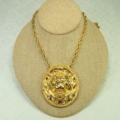 Vintage Lion Head Pendant Necklace. $16.50, via Etsy.