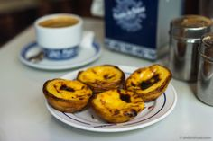 Discover the world famous pastel de nata of Pastéis de Belém. These guys make 30.000 of the egg tart pastry every day, and the place is packed.