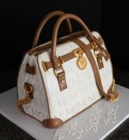 Handpainted Michael Kors purse cake with chocolate trim and edible gold hardware