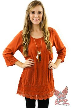Fall On Me Tunic - This adorable v-neck tunic comes in one of the hottest colors this fall season. It's beautiful orange rust color is sure to warm up your autumn wardrobe. You will fall in love with its intricate lace trim detailing. It's quarter length sleeves and A-line style ensure a flattering fit and look. Pair with leggings, boots, and your favorite Envy jewelry for a complete look.  | available at http://www.envyboutique.us/shop/fall-tunic/ |  #Envy #Bouti
