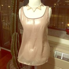 Front Sheer Tank Front of tank is shimmery see-through beige, and back cream. Loose and flowy. Worn once. Size Large. 95% Rayon, 5% Spandex, Contrast: 100% Polyester. Charming Charlie Tops Tank Tops