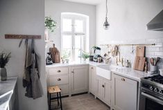 shaker kitchen with gray cabinets designed by devol kitchens. / sfgirlbybay shaker kitchen w Shaker Kitchen, Rustic Kitchen, Vintage Kitchen, Kitchen Decor, 1960s Kitchen, Ranch Kitchen, Kitchen Styling, Diy Kitchen, Kitchen Ideas