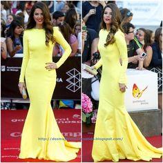 De la clausura del Festival de Malaga, Juana Acosta. Con un impresionante vestido de manga larga amarillo de Lorenzo Caprile. Como complemento un clutch dorado.