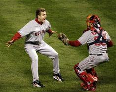 Jonathan Papelbon and Jason Varitek after Papelbon struck out the final batter to secure the 2007 World Series Championship Title.