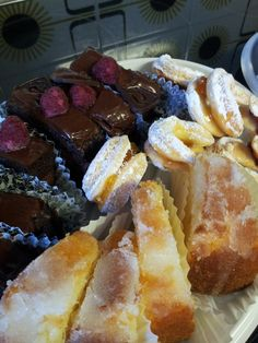 Chocolate mousse cake, lemon drizzle cake and vanilla biscuits filled with jam.