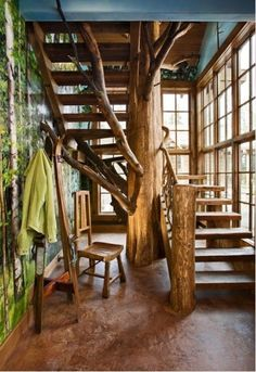 cabin staircase with tree trunk support
