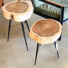 A stunning version of the classic wood stump table with black hammered iron legs and an acacia wood top.