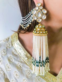 Add a little glam to your Indian wedding outfit by wearing these chic earrings. You can pair these trendy and classy earrings with any ethnic attire. OTT earrings will surely take your reception/haldi/mehndi/wedding outfit a notch higher. Indian Jewelry Earrings, Indian Jewelry Sets, Jewelry Design Earrings, Indian Wedding Jewelry, Designer Earrings, Indian Bridal, Jewelry Box, Jewelry Pouches, Pakistani Jewelry