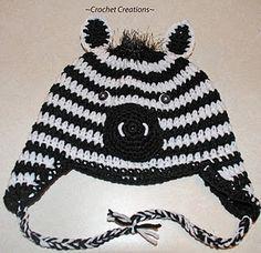 Zebra Child Ear flap hat - great site for kids crochet patterns