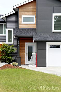 """Exterior home in vinyl siding iron ore with hardi panels and cedar shiplap style panelling. (Don't know 'bout that """"vinyl"""" siding) Looks very nice except for that."""