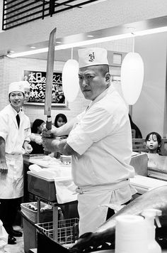 Man of the knife by Robert Mallon. || Tencho sushi chef, Kawamata-san, entertains customers before serving up a large tuna delivered straight from Naha port, Okinawa
