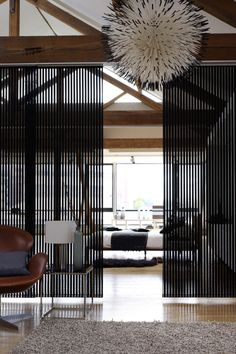Vertical blinds make great room dividers in either a modern or traditional decor. #interiordesign #verticalblinds