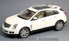 "2014 Cadillac SRX. 1:18 scale diecast car in Platinum Ice White. This diecast car measures approximately 10.5"" long and features a detailed interior, opening doors, hood and tailgate. Part #:  G007W. Click on the picture for more information about this diecast car!"