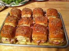 2 -12 packages of sweet Hawaiian rolls (the small dinner roll looking ones)  1 1/2 lbs of Virginia ham (NOT honey ham)  12 slices Swiss cheese  1 stick of real butter  2 teaspoons Worcestershire sauce  1 teaspoon Garlic Powder  1 teaspoon Onion Powder  1 teaspoon poppy seeds  375 oven 15 min foil cover can make ahead good room temp