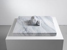 Ai Weiwei | Exhibitions | Lisson Gallery: Mask, 2013. A ghostly, carved-marble gas mask, like a deaths-head emerging from a tomb, relates to the perpetual pollution experienced in the Chinese capital city.