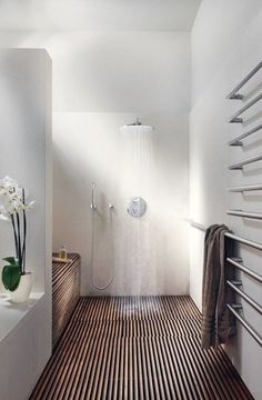 17 a modern space a with wood clad shower, matte white walls and an orchid for a chic touch - DigsDigs