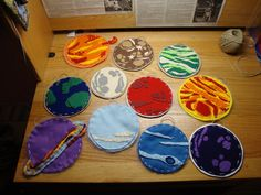 planets made out of felt and embroidery