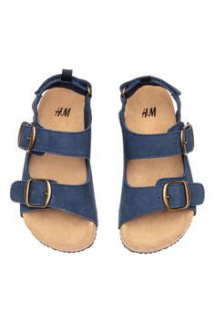 Check this out! PREMIUM QUALITY. Sandals in grained leather with adjustable straps with metal buckles and concealed elastication. Adjustable heel strap with hook-loop fastener and loop at back. Molded suede insoles and fluted rubber soles. - Visit hm.com to see more.