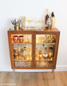 How to DIY a retro mid-century cocktail cabinet for your festive parties Diy Home Bar, Bars For Home, Alcohol Cabinet, G Plan Furniture, Retro Interior Design, Modern Buffet, Barn Kitchen, Bar Cart Decor, Retro Bathrooms