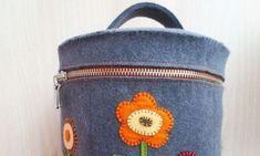 Transporte os seus itens de forma bem charmosa com uma frasqueira de feltro decorada com os elemento