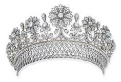 The Palffy Diamond Tiara, By Kochert: Designed as detachable graduated floral motifs with scroll stems, collet and foliate spacers to the detachable diamond collet, lattice and twisted band, circa 1870. One of the richest and most influential families in the region from the 17th to 19th centuries, Karl Hieronymus Graf Palffy von Erdöd was elevated to the status of an Austrian Prince in 1807. Photo Christie's Image Ltd 2004.