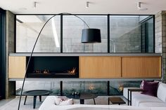 The sitting area, with its sleek fireplace, looks out on the inlet.