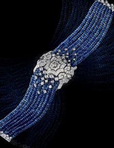 CARTIER. High Jewelry secret hour watch, quartz movement. Rhodiumized white gold case - 634 sapphire beads totaling 115.79 carats, 186 diamonds. #Cartier #DépaysementDeCartier #2012 #HauteJoaillerie #HighJewellery #FineJewelry #Sapphire #Diamond