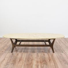 This mid century modern coffee table is featured in a solid wood with a dark walnut finish. This coffee table is in great condition with a durable oval marble top with an off white cream tone and sleek modern base. Retro coffee table perfect with tons of character! #midcenturymodern #tables #coffeetable #sandiegovintage #vintagefurniture