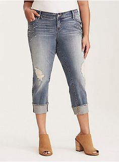 <div>Our White Label denim is casual American style - designed and fit just for you. It's authentic, lived-in fashion that's fun and sexy. <i>Wear what you love</i>.</div><div><br></div><div>This hand-sanded medium wash denim has that coveted vintage look with extreme fading and ripped destruction; however, the relaxed hip and thigh plus a slim straight leg feel brand new. Floral embroidery details the sides of the thighs, giving a folksy touch to the tomboy style. A frayed crop hem keeps…