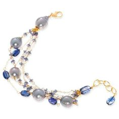 Ferrari Gioielli Ladies' Bracelet in Yellow Gold Filled 14kt Bronze with Cultivated Pearl and Kyanite, form Fantasy, weight 15 grams Ferrari Gioielli. $263.93. Save 20%!