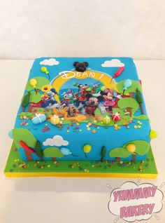 Mickey Mouse Clubhouse friends birthdaycake bright blue green yellow square balloons Minnie Donald Pluto Goofy