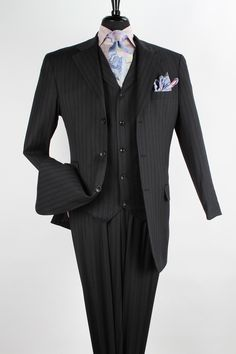 This Apollo King men's 3 piece 100% wool suit comes in fashion length. The single breasted 3 button, 33 inch jacket includes notch lapel, besom pocket, flap pockets and side vents. 3 piece suit comes with single breasted 5 button high fashion vest with notch lapel and belt at back as well as double pleated wide leg pants lined to the knee. Available in luxurious 100% wool fabric.