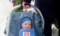 What a cutie he is! This little guy is staying safe and warm in a baby parka for the car seat in blue.