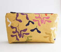 Standing Zip Pouch Cosmetic Bag in Piper Airplanes Print in Mustard and Lined in Piper Zig Zag Print in Punch by ShannonFraserDesigns on Etsy #makeup #cosmetics #storage #practical #pretty