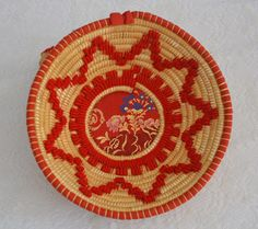 Basket  in straw and rush, decoration in scarlet cloth