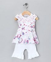 Days of bland and boring be gone with this lovely set on hand. With plenty of style and comfort too, it's the one outfit that you can expect to see appearing in just about every family photo. Includes top and pants 100% cottonMachine wash; tumble dryImported