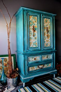 Weathered Armoire with Vintage Paper http://re-tiqued.blogspot.ca/2014/05/weathered-armoire-with-vintage-paper.html