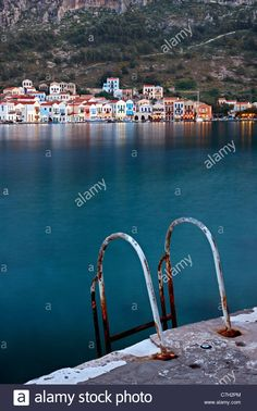 Stock Photo - A ladder for swimmers in the picturesque harbor of Kastellorizo island, Dodecanese, Greece. Mediterranean Sea, Swimmers, Long Exposure, Ladder, Islands, Greece, Remote, Landscapes, Scenery