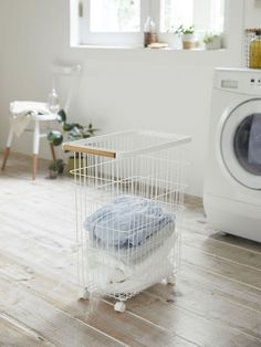 Yamazaki's New Collection Includes a Laundry Item That's Already in High Demand Magnetic Storage, Key Cabinet, Nook And Cranny, Laundry Hacks, Printer Paper, Japanese House, Storage Rack, Washing Clothes, Storage Spaces