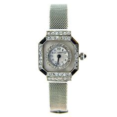 CARTIER, Art Deco Platinum, Diamond, Onyx and Rock Crystal Watch, N.Y. ,ca. 1920's.