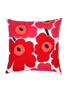 Pieni Unikko cushion by Marimekko. This stunning cushion features the iconic Marimekko poppy print in a bright, bold red and pink colour. Match with other striking cushions for a stylish look in the living room or in the bedroom.
