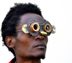 cyrus kabiru sculpts artistic eyewear from found objects + recycled materials