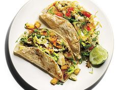 Chimichurri Halibut Tacos | Happy grilling season.We've handpicked our best seafood grilling recipes to prepyou for a summer full of outdoor festivities. This list includes shrimp, salmon, trout, tuna, bass, halibut, oysters, clams- you name it.Now that you're fully-equipped, it's time to fire up the grill and put these 44 recipes to the test. We promise they won't disappoint.