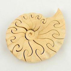 Wooden Ammonite Jigsaw, by Philippine Sowerby
