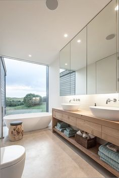 Turn to the vanity to introduce wooden element into the modern bathroom