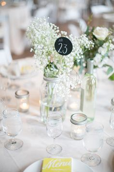 #mason-jars, #babys-breath, #centerpiece Photography: erin jean photography - erinjeanphoto.com Read More: http://www.stylemepretty.com/2013/08/06/milwaukee-wedding-from-erin-jean-photography/