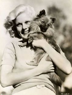 Jean Harlow was a huge animal lover and always had a menagerie of animals in her home including dogs, cats, and even ducks. I believe this is Oscar thePomeranian who legend has it quit eating after Jean passed away.