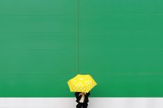 Woman holding a yellow umbrella